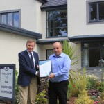 The Right Honourable David Jones, MP for Clwyd West, presents Steve with his Pride in the Job certificate at the Sherwood show house on Ravenscroft's Briarswood development in Colwyn Bay